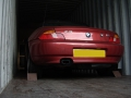 BMW Z3 secured in shipping container