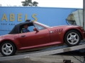 BMW Z3 unloading from shipping container with ramps