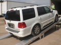 Lincoln Navigator on loading ramps