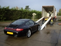 Porsche Carrera lined up ready for loading into shipping container